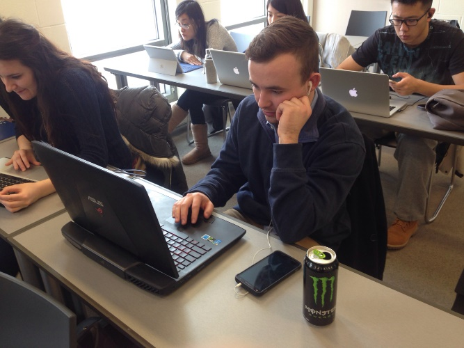 Team 2 Leader Nick Bolander studying away with the home team, energy drink at hand