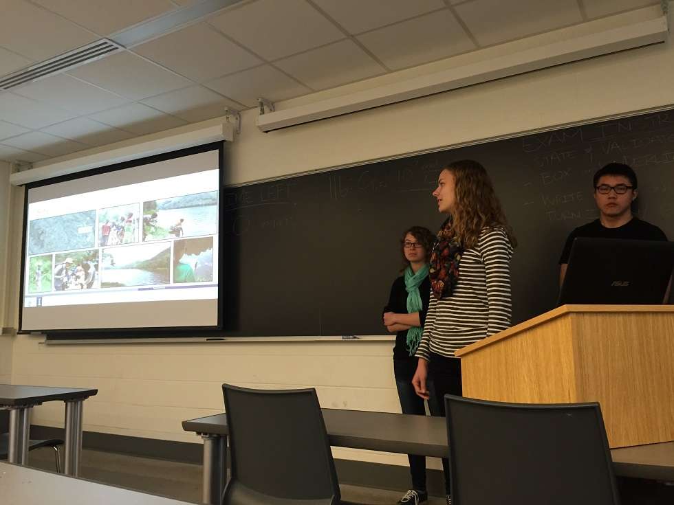 Sylwia Kokoszka, Hannah Lohman, and Wei Quan presenting their findings during the site assessment trip to Rwanda to the rest of the class