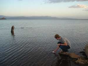 Daniel Mosiman takes a water sample for quality analysis from Lake Baringo