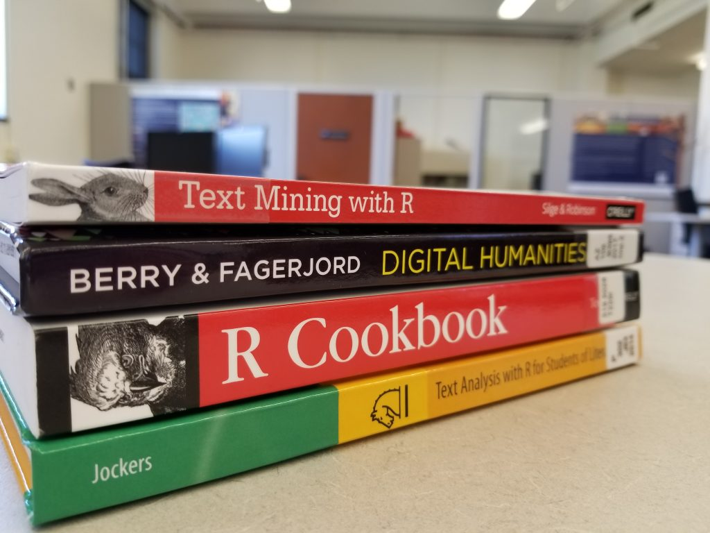 Stack of books in the Scholarly Commons