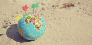 A globe on a beach