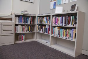 The Scholarly Common reference collection. Six shelves filled with books.