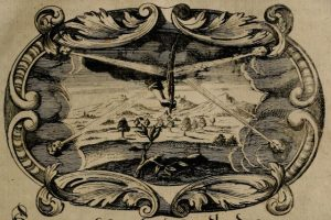 Example of an emblem. A black and white print with a decorative border, depicting the four winds as cherub faces blowing into the center where a hand holding a quill is descending from the sky to the earths surface.