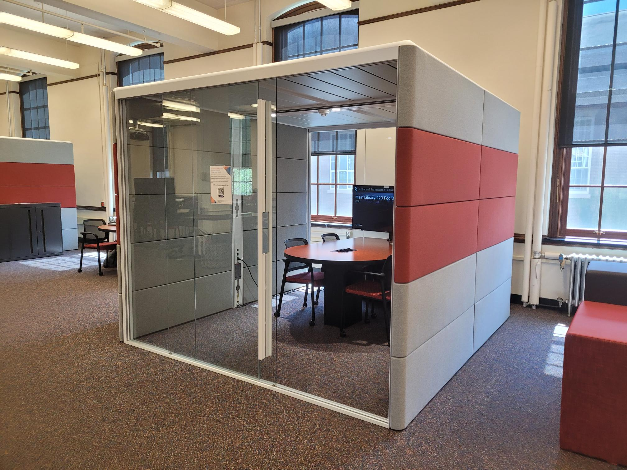 Individual study pod with clear glass doors