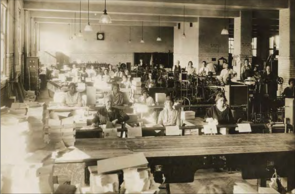 Image of workers at the government publishing office pamphlet making room.