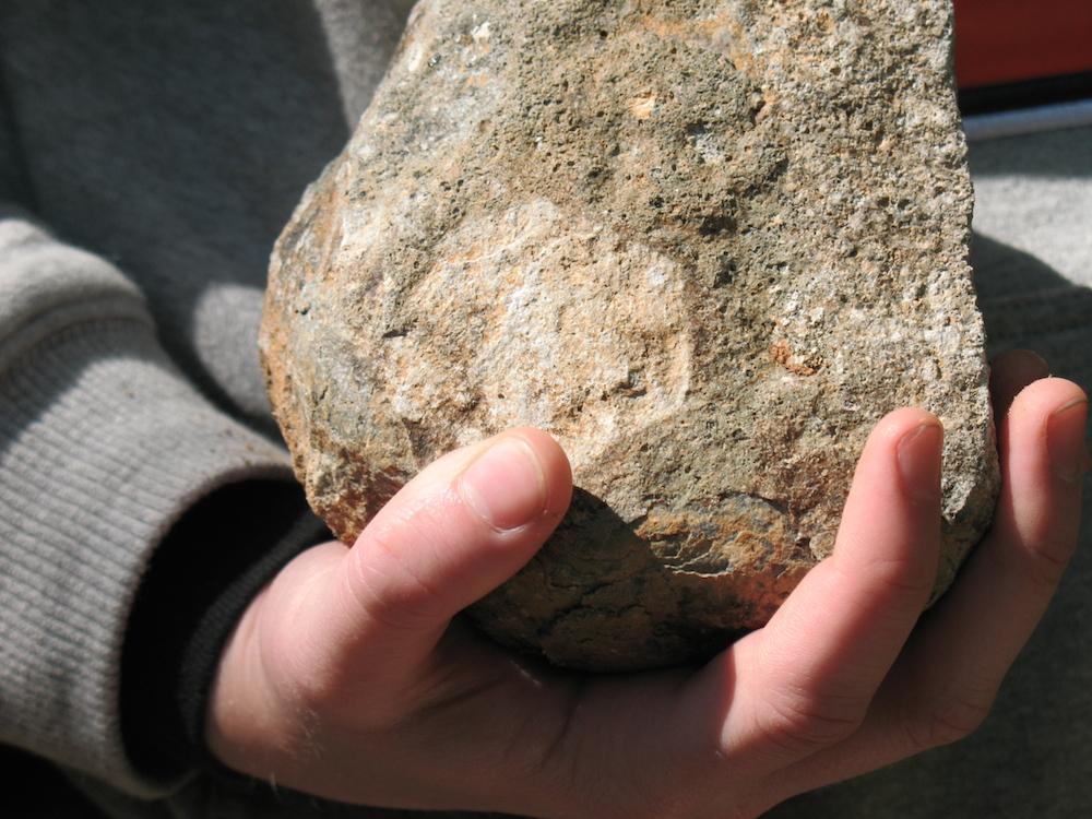 Rock in hand