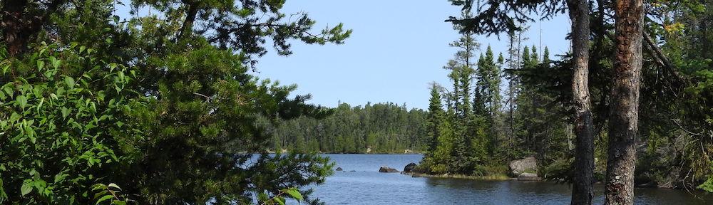 Lake, rocks & fir trees