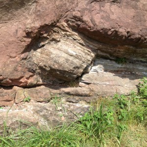 Evidence that granite is an intrusive rock observed by James Hutton at Holyrood Park in Edinburgh, Scotland.