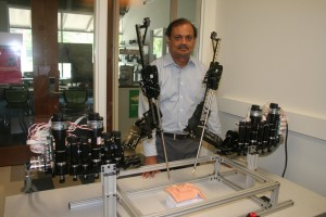 Dr. Kasavadas stands with a tele-surgery robot