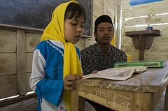 A young girl learns to read the Koran. Photo Credit: Plan Asia