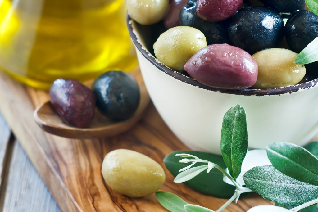 Multiple types of marinated olives, a common food eaten in the Mediterranean. Photo Credit: Speleolog from Flickr