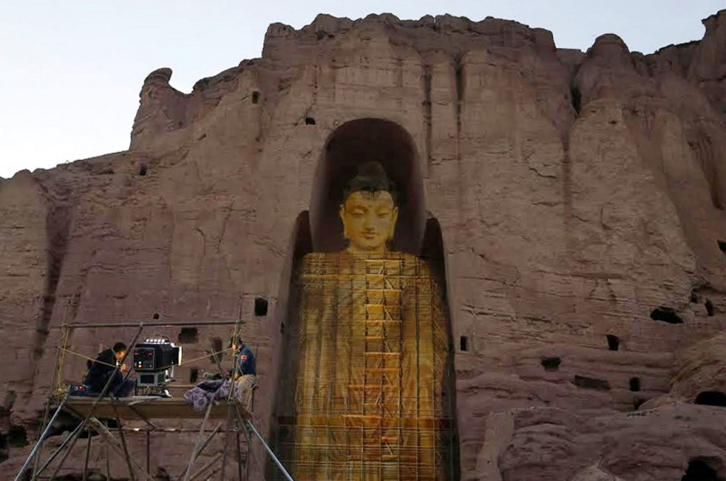 One of the two Bamiyan Buddhas recreated as 3D light projection [Credit: AFP] Read more at: http://archaeologynewsnetwork.blogspot.com/2015/06/bamiyan-buddhas-rise-again-in-3-d.html#.VjenjmNXnQQ Follow us: @ArchaeoNewsNet on Twitter | groups/thearchaeologynewsnetwork/ on Facebook