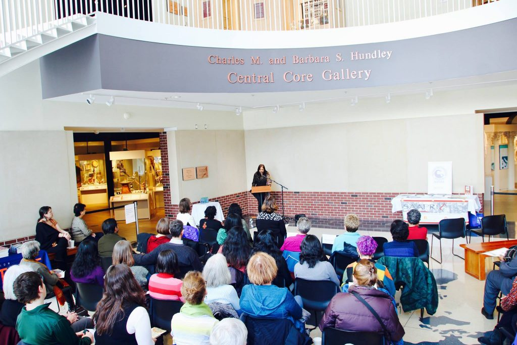 """Dr. Koeli Goel gives remarks at the kick-off event at the Spurlock Museum for the NEA Big Read on Jhumpa Lahiri's """"The Namesake""""."""