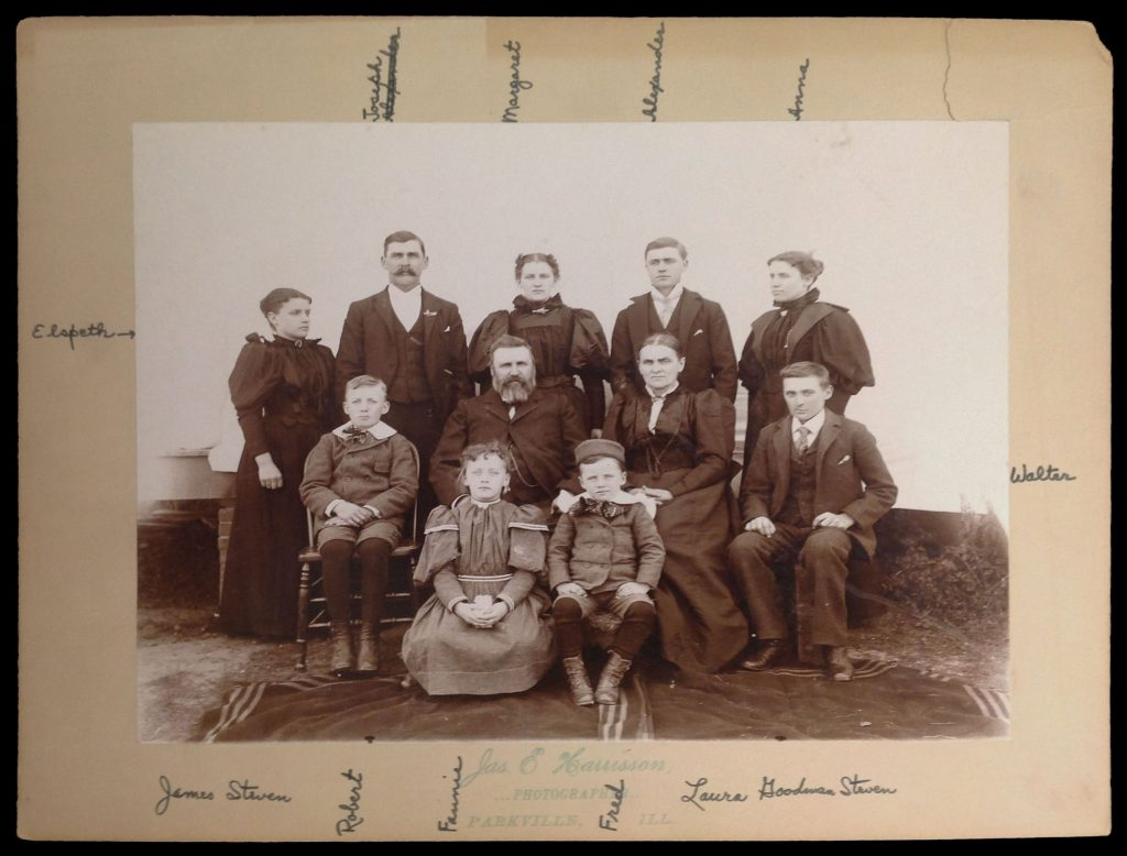 Photograph of James and Laura (Gutmann) Steven with their nine children, circa 1890s.