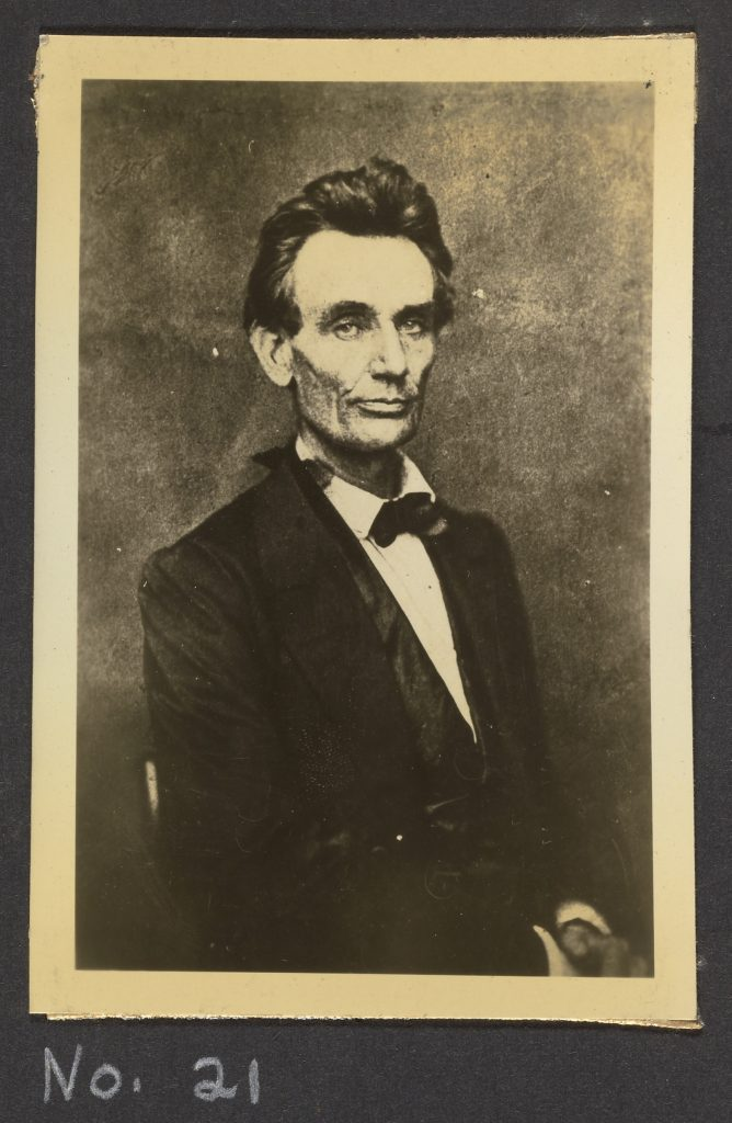 Black and white photo depicting Abraham Lincoln from the waist up.