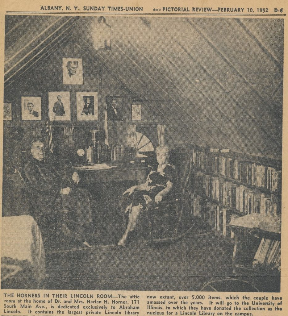 Newspaper clipping of photo showing the Horners in the attic room in their home dedicated to their Lincoln library