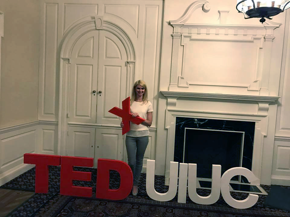 Kalina Borkiewicz posing with the TEDxUIUC logo