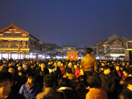 Crowds in Beijing, China, celebrate Lantern Festival near Tiananmen Square. Credit: Grace Kenney.