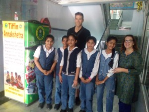 Robbie and Alison, interns from US doing internship on food wastage at Annakshetra, with the students in school premises. / photo courtesy of Annakshetra