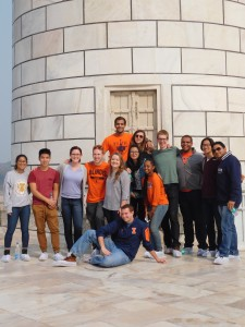"Students and faculty pose in front of one of the ""leaning towers"" of the Taj Mahal. Photo credit: ADMI"