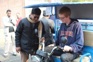 UIUC student Matt Niewiara gets a lesson in driving the postharvest fishery vehicle at CIPHET. Photo credit: ADMI/Shean Lin