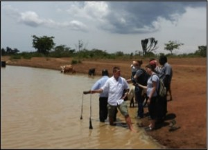 A group of people collecting water samples.