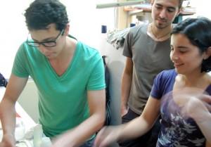 Camilo, Carolina, and Ignacio at work in the lab