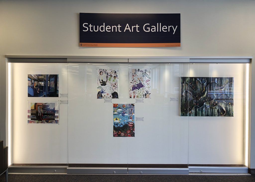 The first display case of The Undergraduate Library Student Art Gallery with the current set of artwork.