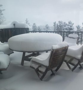 The outside table covered in a mound of snow