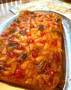 pineapple upside down cake, made with pineapples, cherries, and toasted pecans