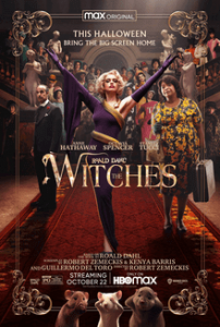 Movie poster, image of a woman with her arms outstretched standing on a red carpet while others look over her shoulders. Title The Witches.