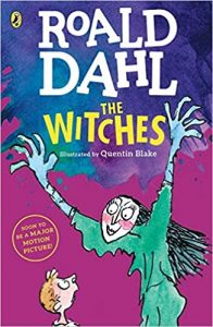 Book cover with an illustration of a woman in a green dress standing arms outstretched over a small boy. Title The Witches.