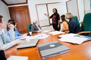 Faculty/staff member gesturing during a meeting.