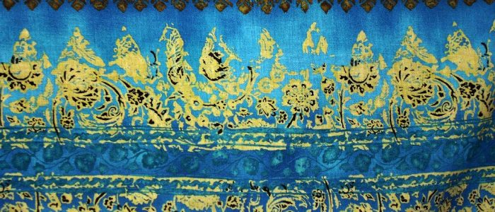 A closeup of blue and gold fabric