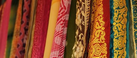 An array of silks hanging on a wall