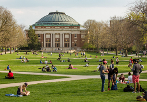 Image of the main quad with students sitting in grass